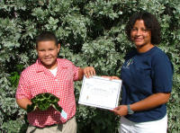 Cayman5 Student winning name competition for tracked turtle - (c) DoE